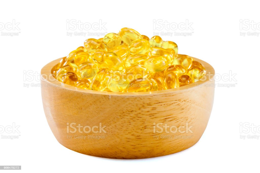 Fish oil, soft capsule, omega, supplement in wood bowl  isolated  on white background with clipping path ,healthy product concept close up stock photo