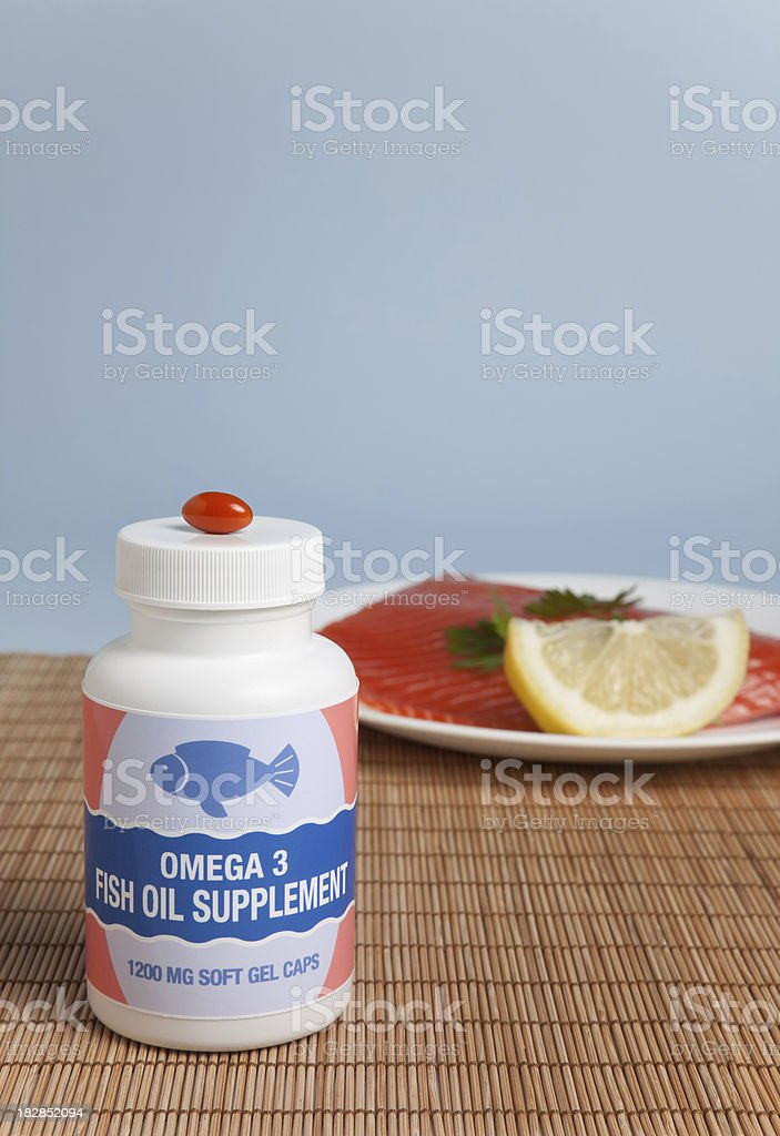 Fish Oil Supplement & Salmon royalty-free stock photo