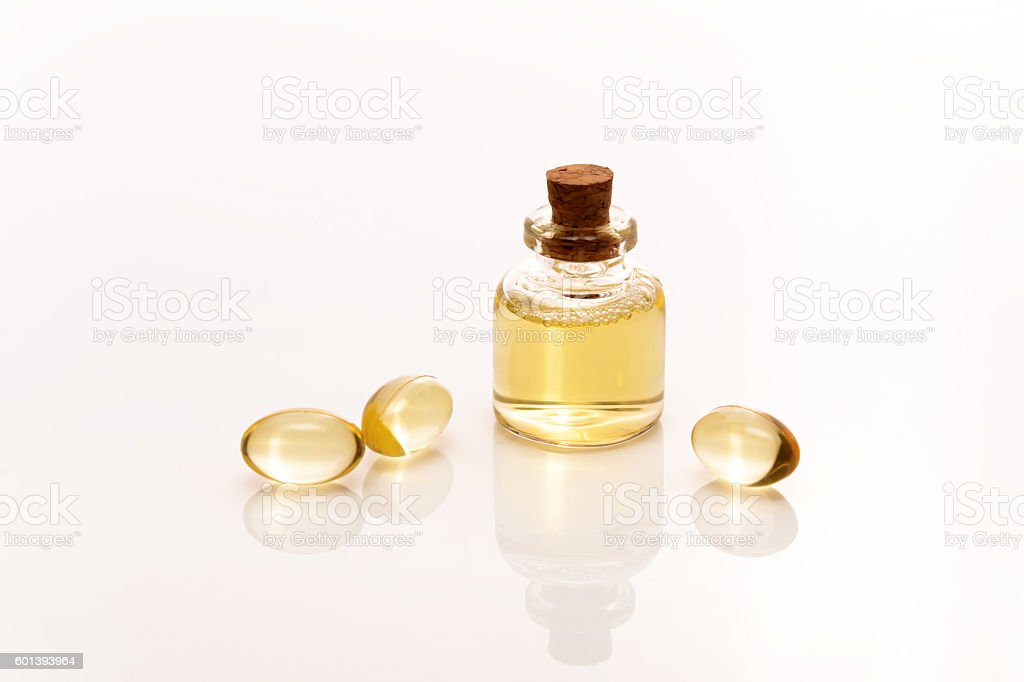 fish oil tablets and liquid stock photo