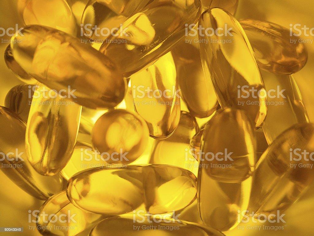 fish oils Omega 3 capsules background royalty-free stock photo