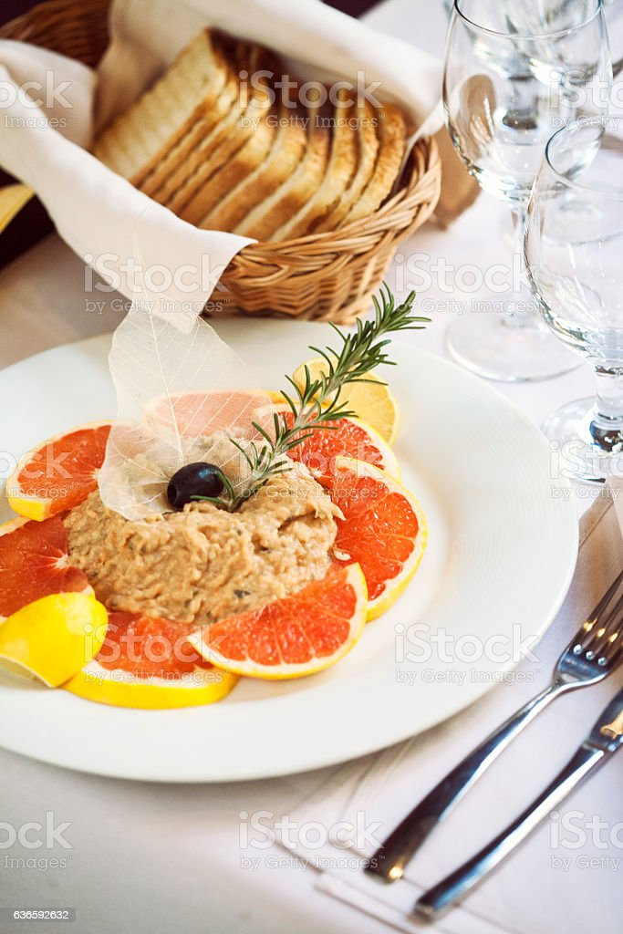 Fish pate with red grapefruit stock photo