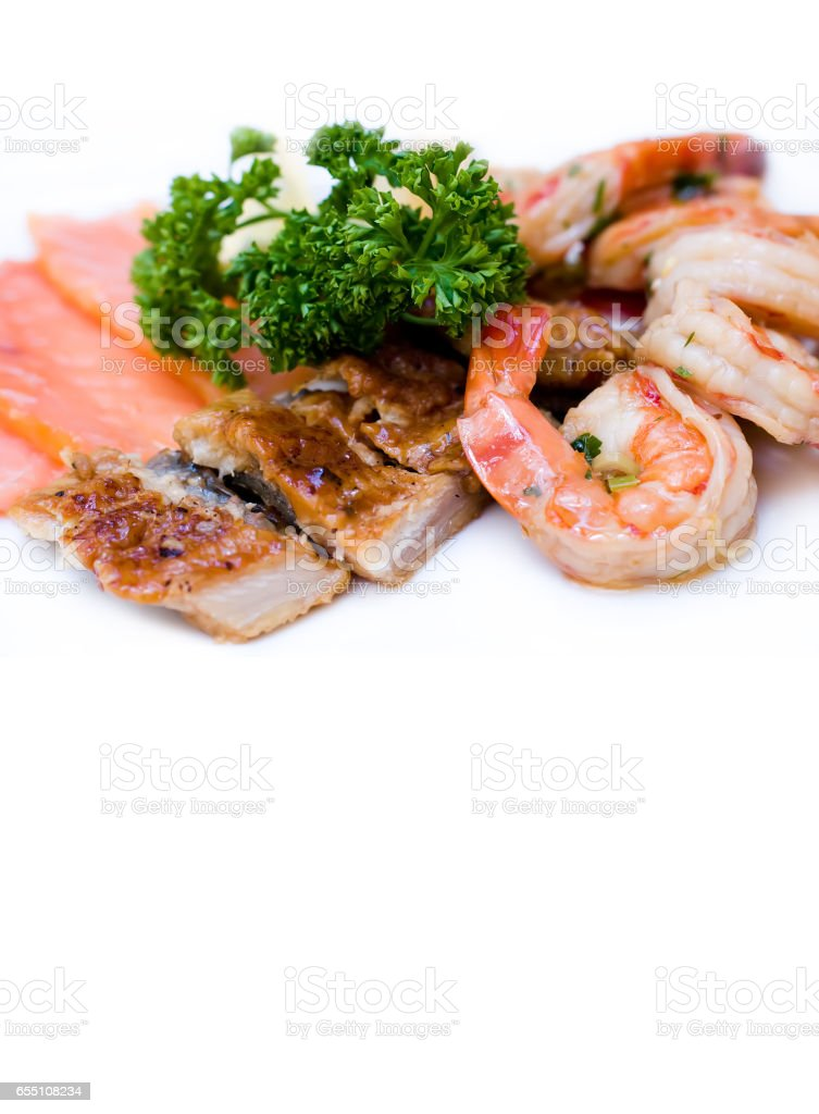 Fish platter marinated shrimp smoked eel Chum salmon on white background stock photo