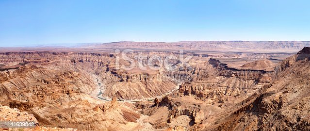 Fish River Canyon during the dry season top view, beautiful scenic mountain landscape panorama in Namibia, Southern Africa