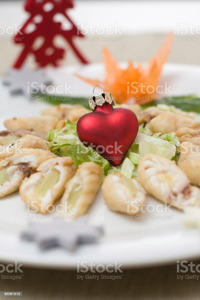 fish rolls with kiwi inside on christmas background royalty-free stock photo
