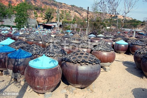 Vietnamese fish sauce pots. Anchovies and salt are arranged in these typical wooden boxes to ferment and produce a very strong smell.