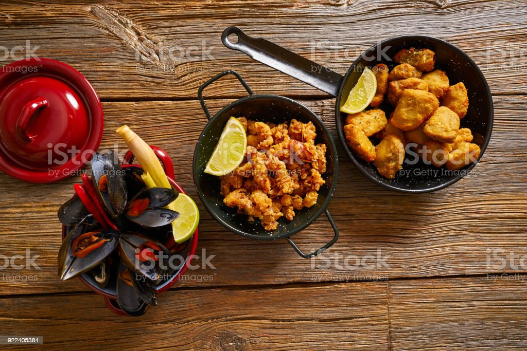 Fish seafood tapas adobo squid and mussels stock photo