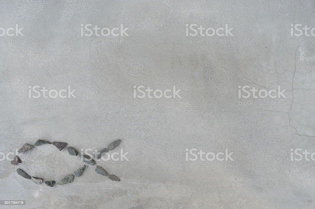 Fish shape on grey background stock photo