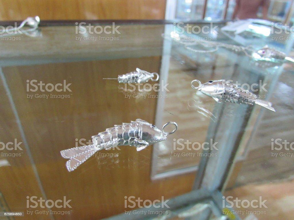 Fish silver pendant necklace stock photo