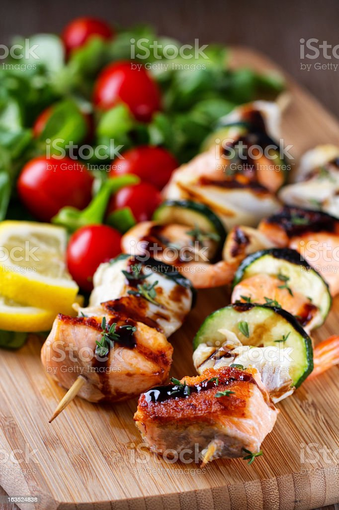 Fish skewers with salad royalty-free stock photo