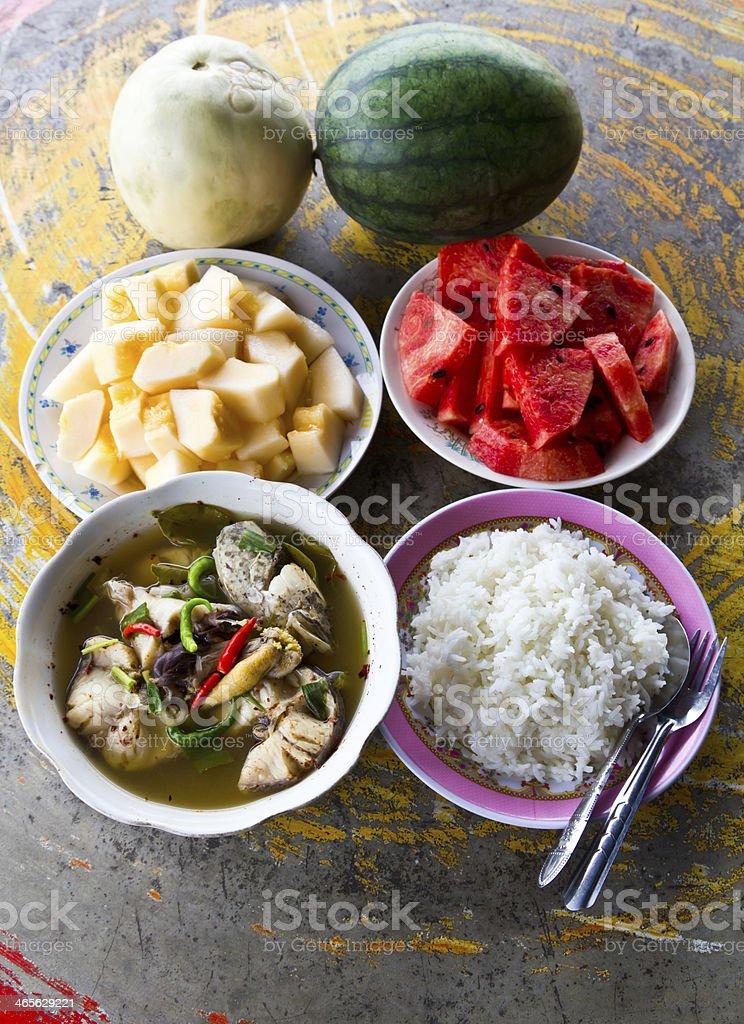 Fish soup cantaloupe and watermelon royalty-free stock photo