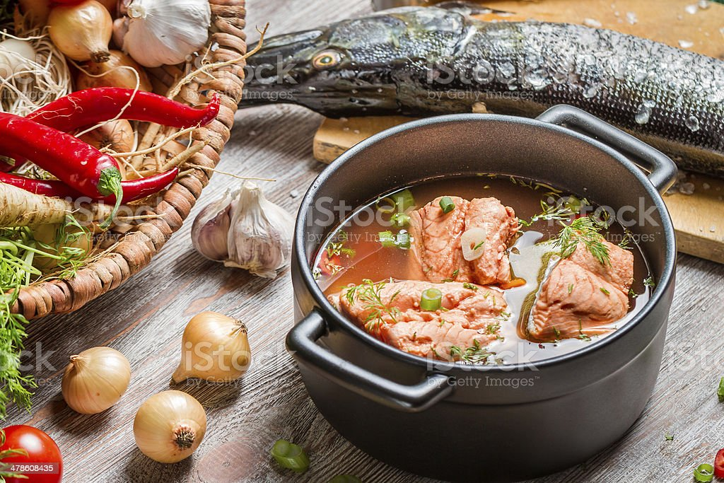 Fish soup made of fresh vegetables and salmon stock photo