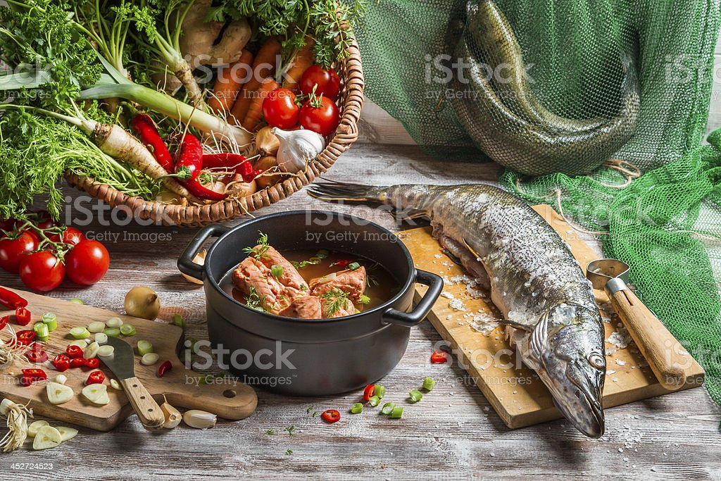 Fish soup made of fresh vegetables stock photo