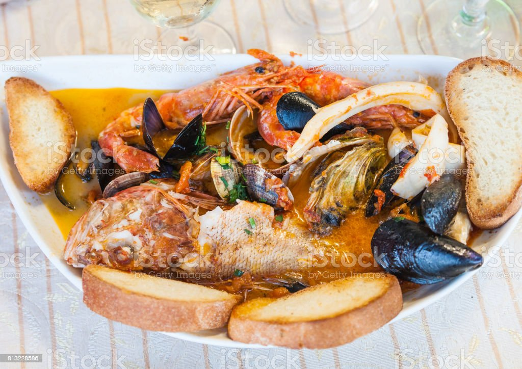 fish soup with seafood in sicilian restaurant stock photo