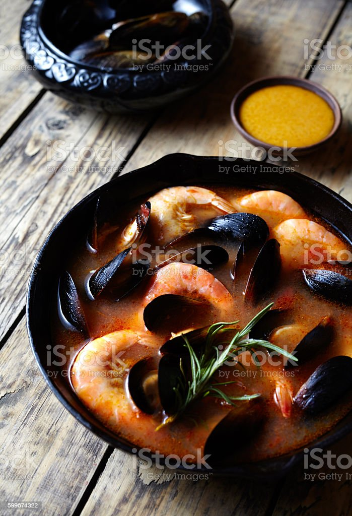 Fish soup with seafood, prawns, mussels tomato, lobster. Sauce Rouille stock photo