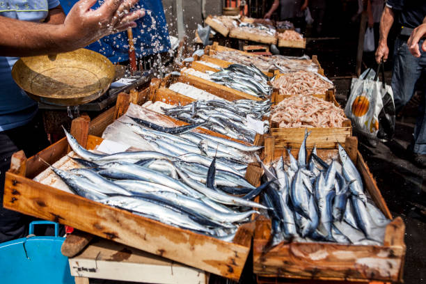 Fish Stall One of the fish stall that you can find at the fish marekt in Catania catania stock pictures, royalty-free photos & images