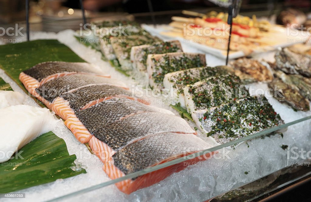 Fish steaks on market display stock photo