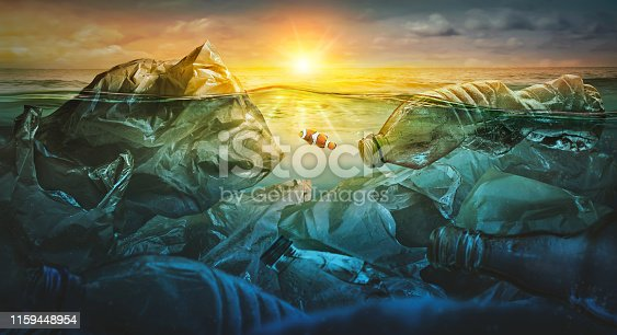 istock Fish swims among plastic bag ocean pollution. Environment concept 1159448954