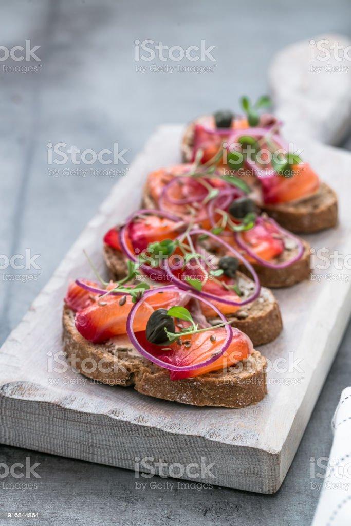 Fish Tapas on wooden board stock photo