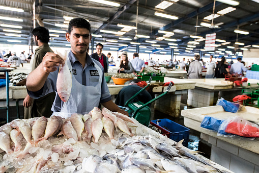 Fish Vendor At The Dubai Fish Market Stock Photo - Download