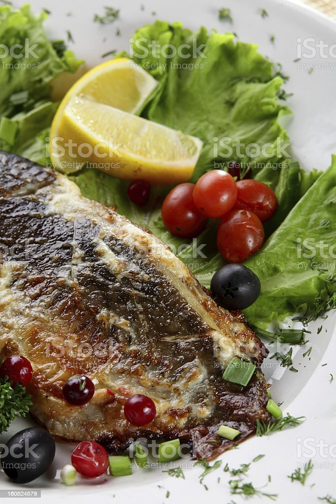fish with berries royalty-free stock photo