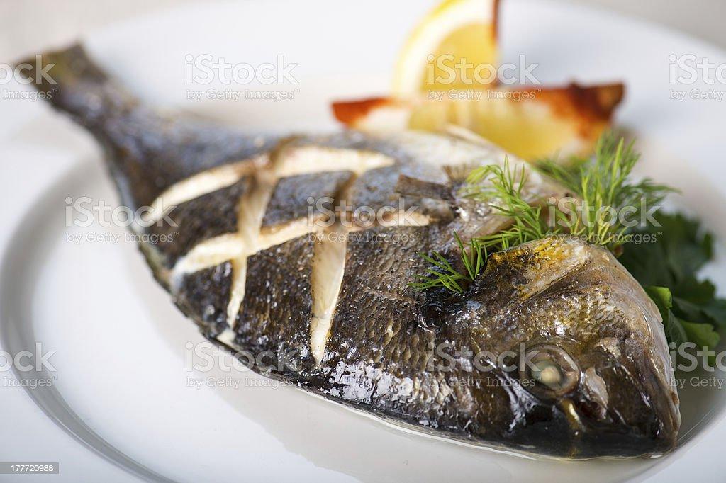Fish with lemon royalty-free stock photo