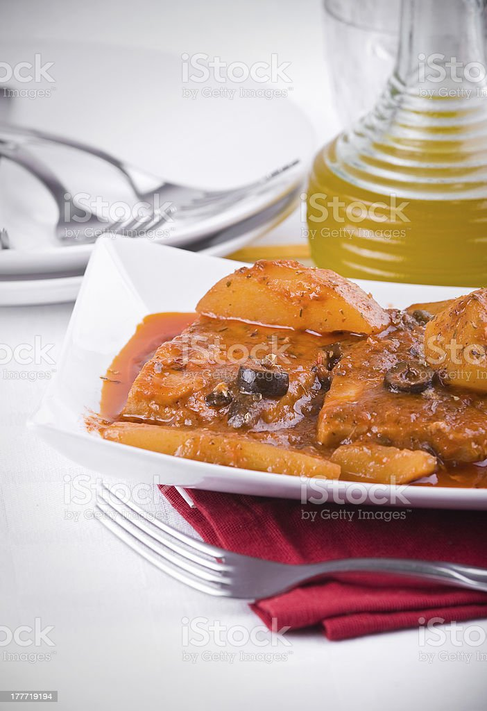 Fish with potatoes and black olives. royalty-free stock photo