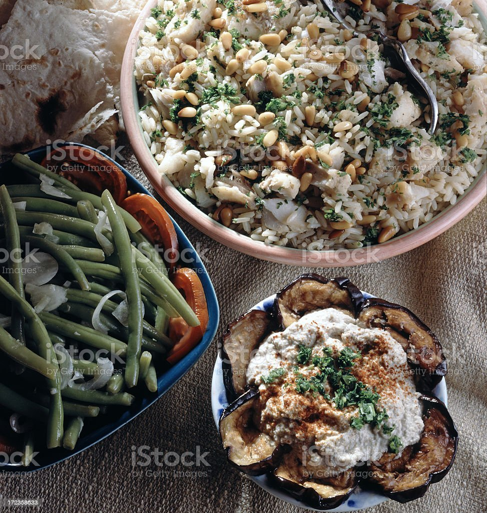 Fish with Rice and pine nuts royalty-free stock photo