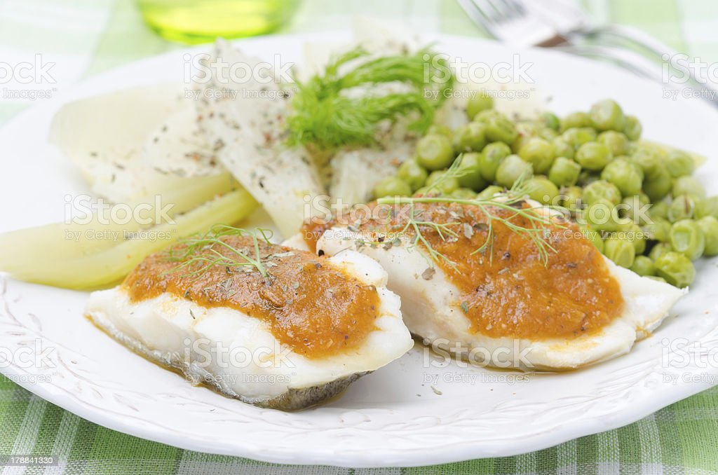 Fish with tomato sauce and vegetables closeup royalty-free stock photo