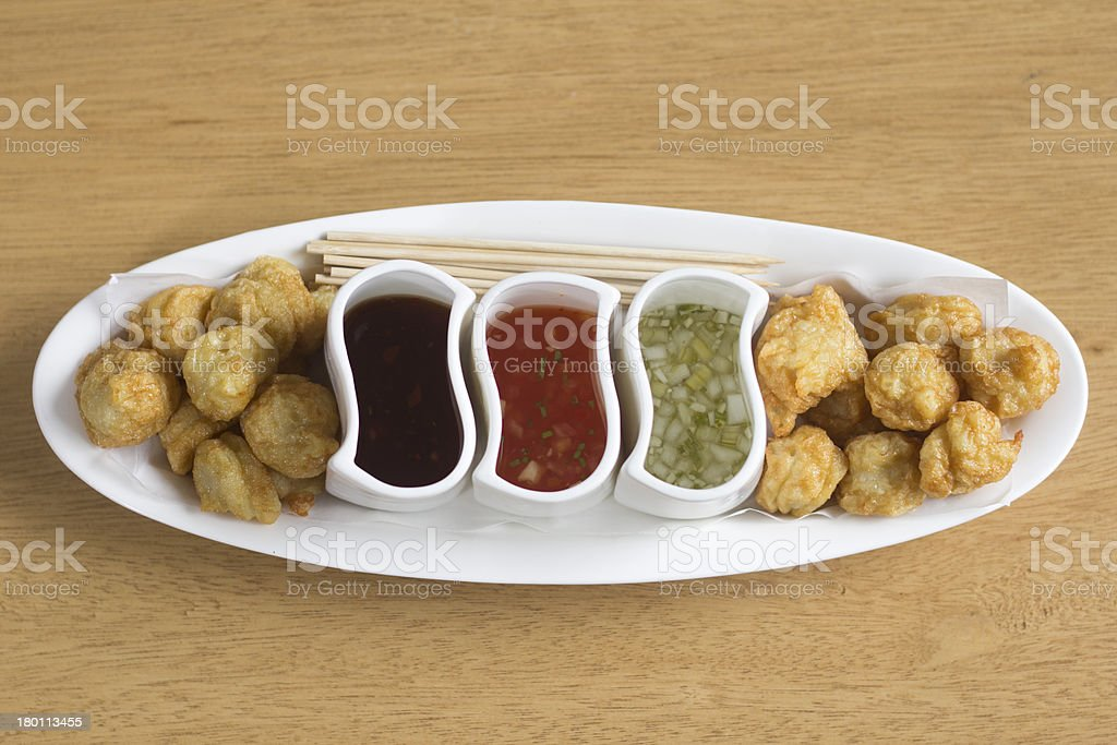 Fishballs served with sauce royalty-free stock photo