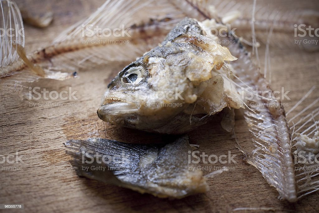 Fishbone on a wooden board royalty-free stock photo