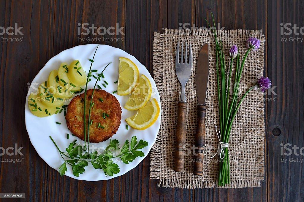 Fishcake and potato salad royalty-free stock photo