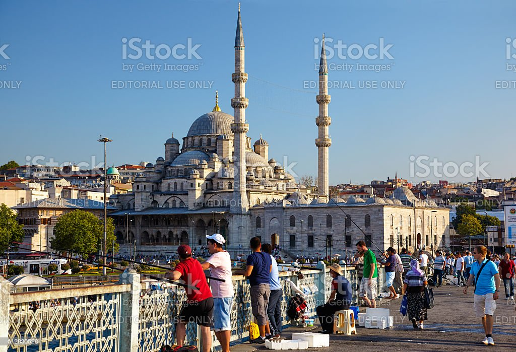 A fishemen on Galata Bridge in front of New Mosque stock photo