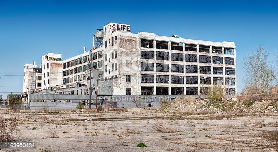 Detroit, Michigan - April 28, 2019:  A panorama view of the old Fisher Body Works factory in Detroit as seen from one of the old parking lots that surround the building.