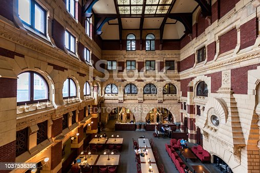 Philadelphia, PA, USA - July 17, 2018:  Readers are reading carefully in the library. This historic library, a National Historic Landmark, is the major masterpiece of Philadelphia's most important Victorian architect, Frank Furness.