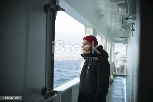 Fisher man on the deck of a fishing boat