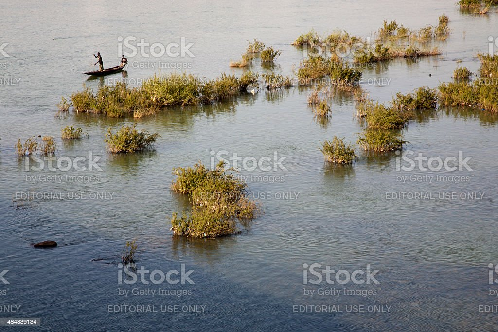 Fisher man working in their boat on the Niger River stock photo