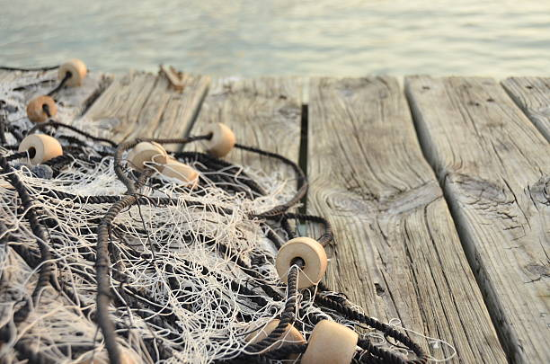 Fisher net on Jetty Fisher net on Pier fishing net stock pictures, royalty-free photos & images