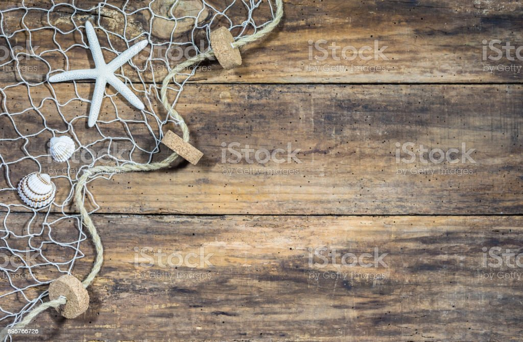 Fisher net with starfish and seashells stock photo