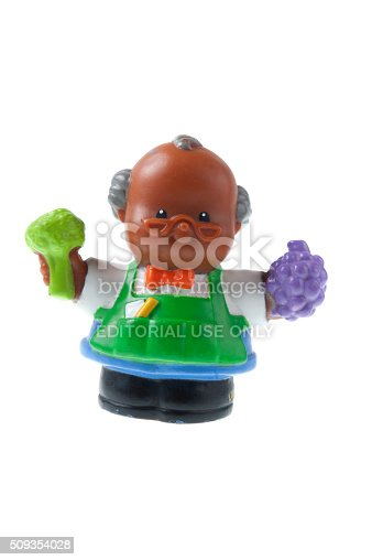 Adelaide, Australia - July 09, 2015: A studio shot of a Fisher Price Little People Green Grocer. A popular developmental toy for young children.