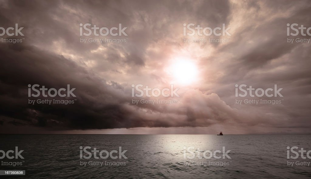 Fisherboat on the ocean before a thunderstorm stock photo