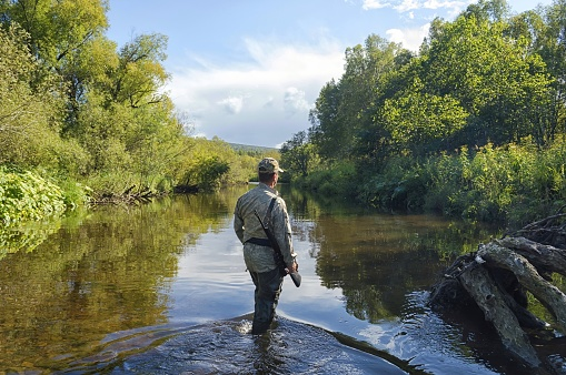 Fisheries Inspector controls order on the spawning taiga river.