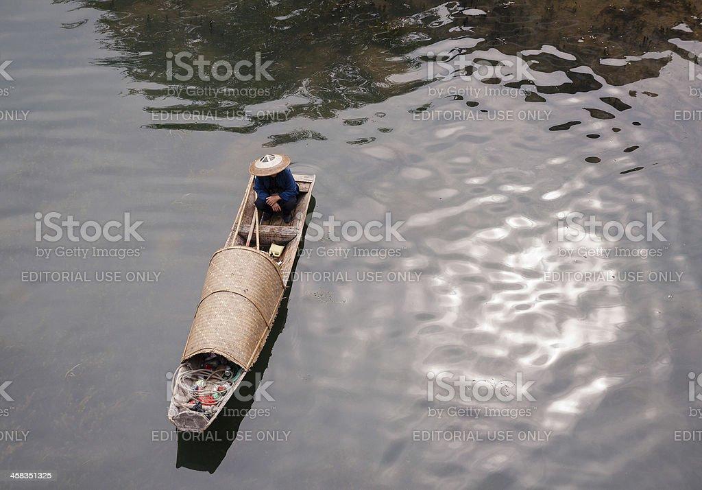 Fisherman and boat royalty-free stock photo