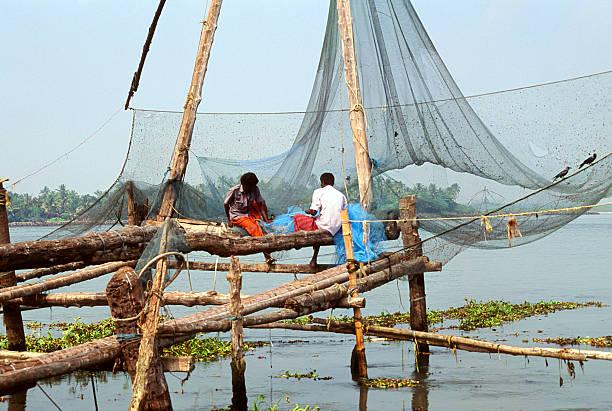 Fisherman and Chinese Fishing Nets stock photo
