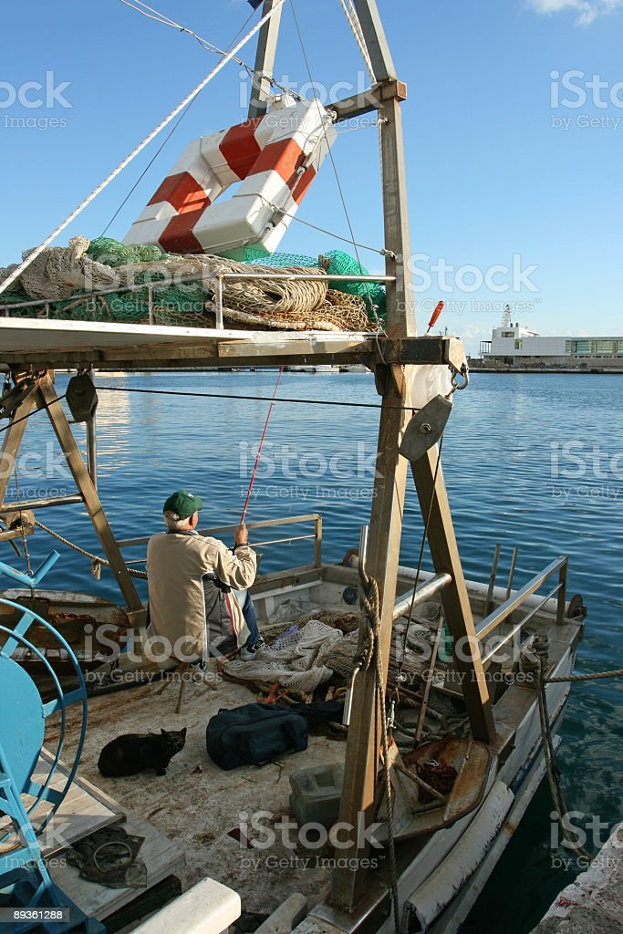 Fisherman and his cat (Rijeka-Croatia) royalty-free stock photo