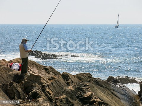 istock Fisherman and saiboat on ocean, Porto, Portugal 496774274