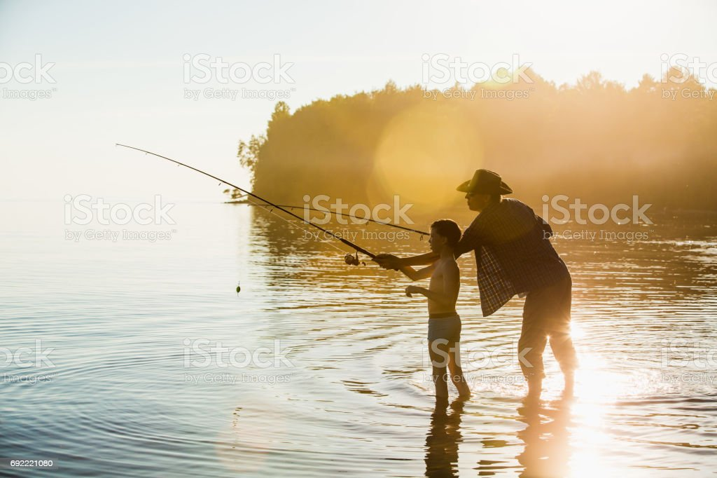 Fisherman and son stock photo