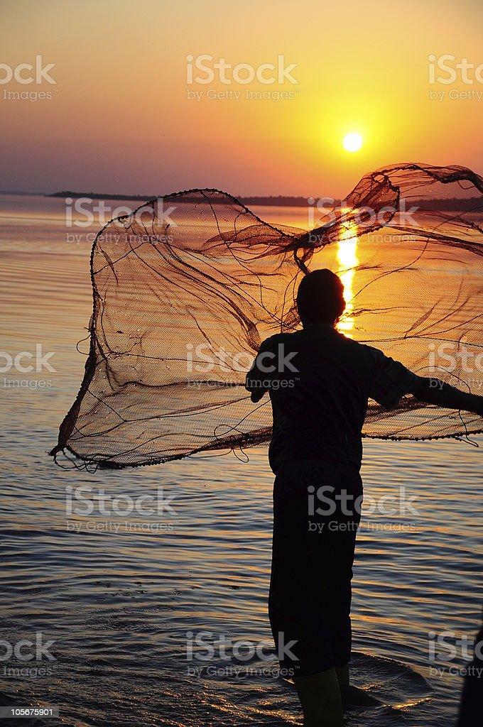 fisherman and sunset stock photo