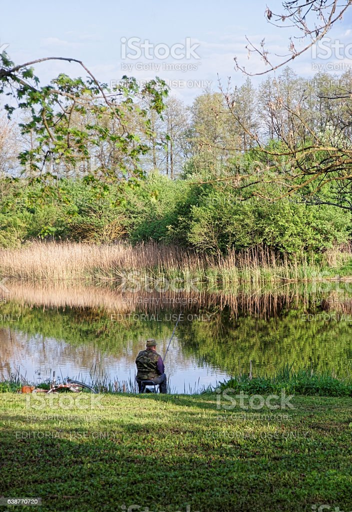 Fisherman at pond in Bialowieza National Park stock photo