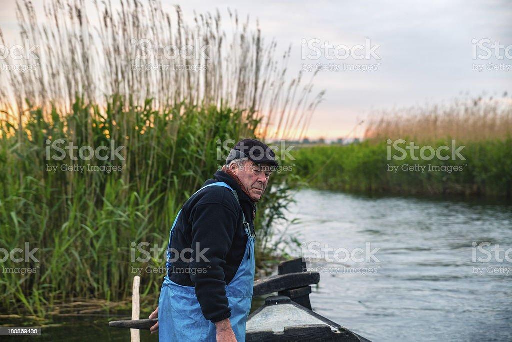 Fisherman at sunrise royalty-free stock photo