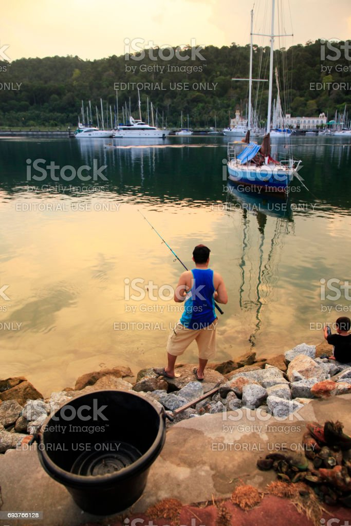 Fisherman at sunset. Island Langkavi, Malaysia stock photo